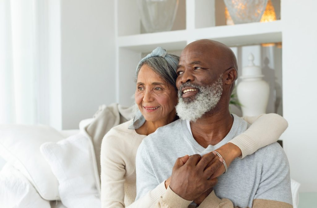 An older couple spending time together and holding hands in their home